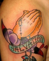 Praying hand and rosary tattoo