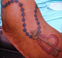 Rosary bead heart tattoo